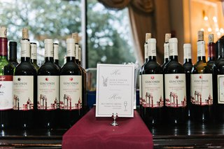 wine-bottles-at-oheka-castle-wedding-reception-with-card-menu-his-and-hers-drinks