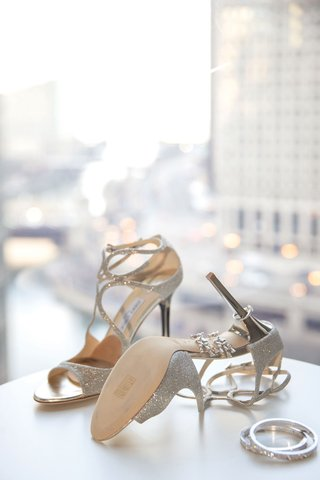wedding detail shot photo of high heels with sparkle design earrings and bracelets for bride