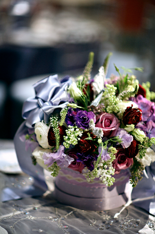 colorful-flowers-with-a-lavender-bow-in-a-ribbon-wrapped-container