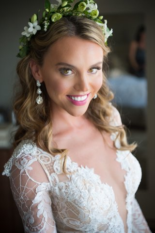 close-up-bridal-shot-pink-lipstick-natural-look-makeup-flower-crown-greenery-dangle-earrings