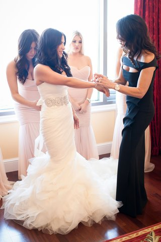 bride-in-vera-wang-bridesmaids-in-amsale-brides-mother-and-sisters-help-her-get-ready