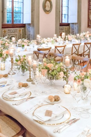 white-table-linen-u-shape-table-greenery-pink-flower-candlestick-bread-plate-wood-chairs