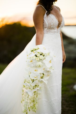 cascading-bouquet-white-orchids-other-blooms-roses-greenery-extended-unique-sophisticated