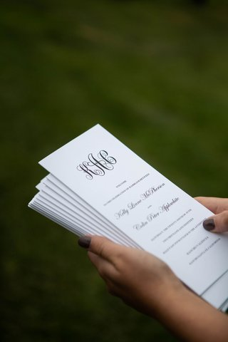 wedding ceremony program with monogram and black white design