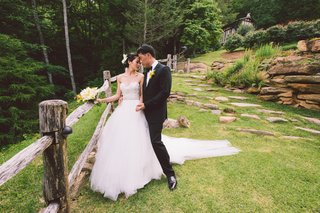 man-in-tuxedo-and-woman-in-wedding-dress-in-grass
