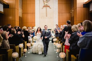 bride-and-groom-walking-up-church-aisle-after-wedding