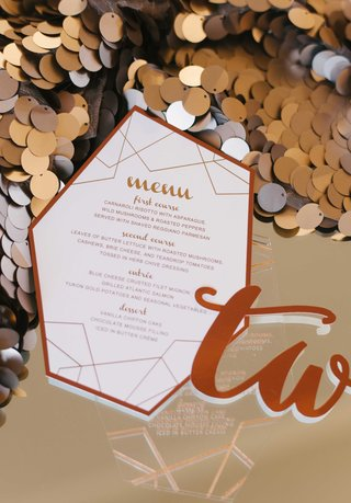 a-contemporary-design-for-a-reception-menu-in-a-copper-color-on-large-sequins
