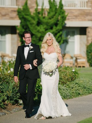 bride-in-a-thin-strapped-galia-lahav-dress-with-lace-panels-white-bouquet-and-father-in-a-black