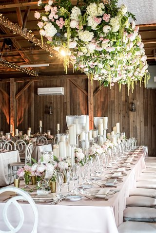 rustic-chic-barn-wedding-reception-floral-installation-over-tables