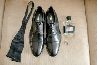 grooms-black-dress-shoes-bow-tie-creed-cologne-silver-cuff-links