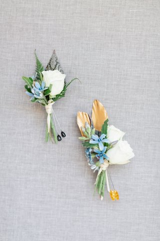 two-boutonnieres-with-white-roses-and-small-blue-flowers