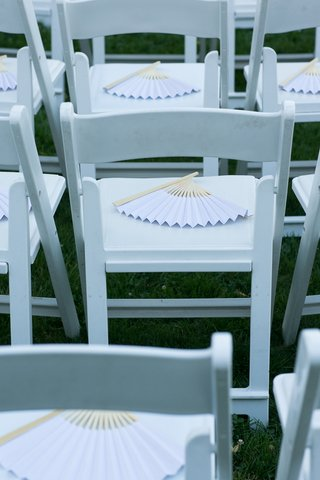light-purple-wooden-fans-on-white-ceremony-chairs