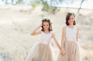 two-flower-girls-holding-hands-in-tan-neutral-wedding-looks-tank-dresses