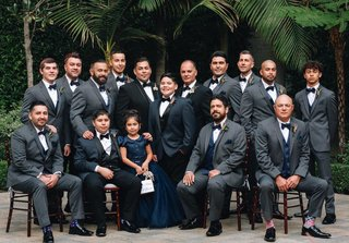same-sex-wedding-inspiration-gay-wedding-with-groomsmen-in-grey-suits-flower-girl-in-navy