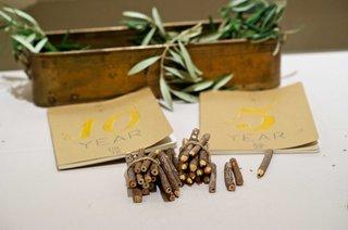 wedding-guestbook-idea-with-5-year-and-10-year-books-with-wood-pencils