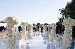 joanna-krupa-wedding-ceremony-aisle-with-flower-columns