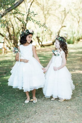 two-flower-girls-with-white-dresses-flower-crowns-flower-wands