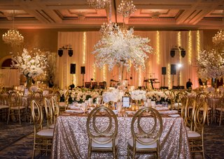 wedding-reception-with-rose-gold-linens-gold-chairs-centerpiece-with-dendrobium-orchids
