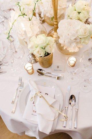 wedding-reception-place-setting-white-linen-monogram-menu-ribbon-on-napkin-gold-candle-votives