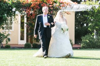 father-of-the-bride-in-black-suit-with-pink-bow-tie-and-daughter-in-oscar-de-la-renta-wedding-dress