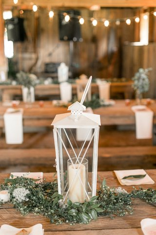 wedding-reception-wood-table-white-lantern-greenery-napkins-leaf-candle-wood-table