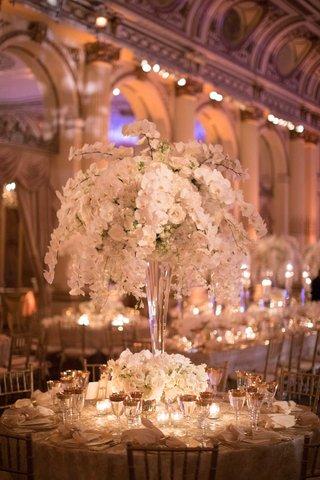 wedding-reception-rount-table-tall-centerpiece-orchid-rose-hydrangea-flowers-gold-rim-glassware