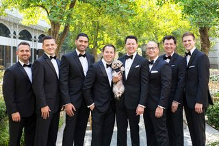groom-groomsmen-smiling-black-bow-ties-dog-little-tuxedo-outfit