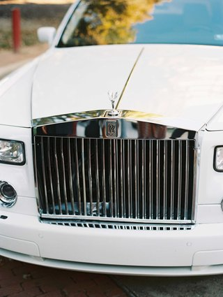 close-up-shot-of-grill-on-rolls-royce-car-white-and-silver