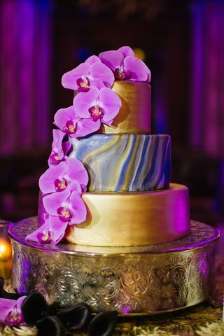 wedding-cake-three-layers-with-fresh-fuchsia-orchid-flowers-gold-layers-and-marble-design-in-center