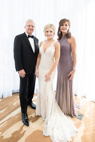 razny-jewelers-family-wedding-lace-wedding-dress-with-mother-of-bride-in-purple-dress-father-in-tux