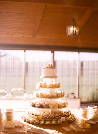 wedding-with-cupcakes-arranged-to-look-like-cake-tiers-topped-with-at-white-cake