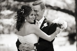 black-and-white-photo-of-bride-and-groom-hugging