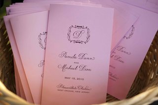 pink-wedding-programs-with-the-couples-monogram