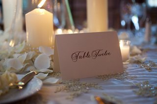wedding-reception-table-number-spelled-out-on-a-cream-card