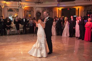 bride-in-a-romona-keveza-dress-dances-with-groom-in-a-black-tuxedo