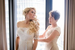 bride-in-off-shoulder-illusion-wedding-dress-long-blonde-hair-curls-flower-headpiece-mother