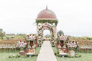 colorful-ceremony-space-outdoors-pelican-hill-resort-newport-beach-wedding-red-pink-flowers-dome