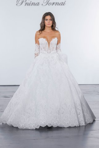 pnina-tornai-for-kleinfeld-2018-wedding-dress-lace-ball-gown-plunging-v-neck-strapless-arm-details