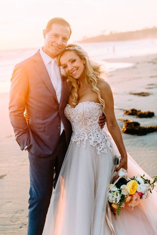 bride-in-custom-trish-peng-wedding-dress-strapless-jewel-headpiece-headband-long-blonde-hair-curls