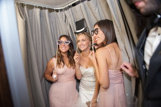 bride-and-bridesmaids-in-silly-photobooth