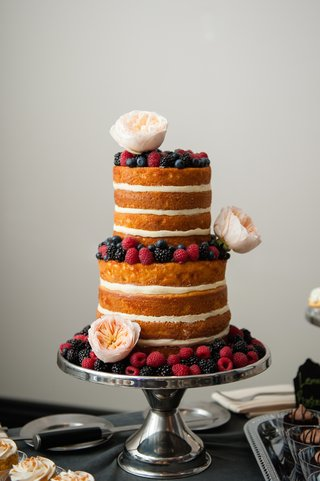 cake-without-frosting-topped-with-raspberries-and-flowers