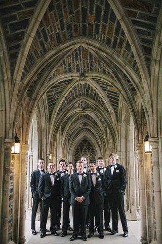 groom-and-groomsmen-in-tuxedos-at-duke-chapel