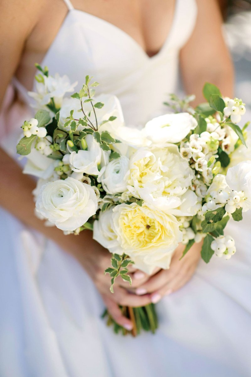 Bride Holding White Bouquet with Greenery