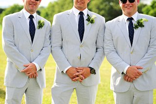 groomsmen-in-blue-seersucker-suits-navy-ties-with-dots-and-calla-lily-boutonnieres