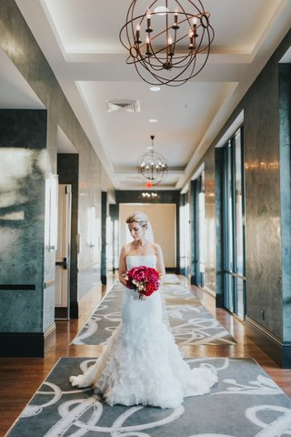 bride-in-liancarlo-ruffled-trumpet-gown-bouquet-with-scarlet-peonies