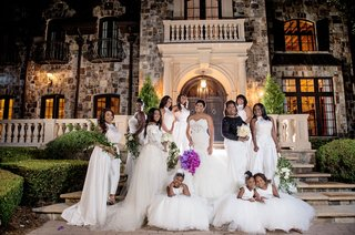 wedding-at-private-estate-bridesmaids-in-white-pantsuits-with-overskirts-greenery-and-white-flowers