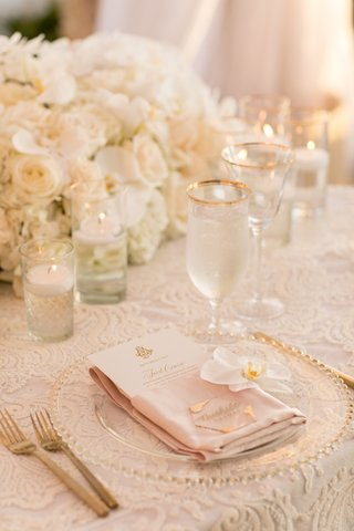 wedding reception white lace linen gold bead charger white orchid gold forks and glassware
