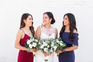 bride-in-claire-pettibone-dress-with-bridesmaids-in-navy-and-oxblood-red-dresses-mismatched-styles