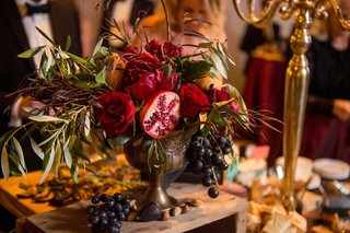 fruit-display-still-life-decor-concept-renaissance-theme-flowers-grapes-vase-stand