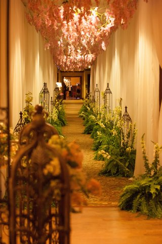 wedding-reception-hallway-entrance-with-pink-flowers-from-ceiling